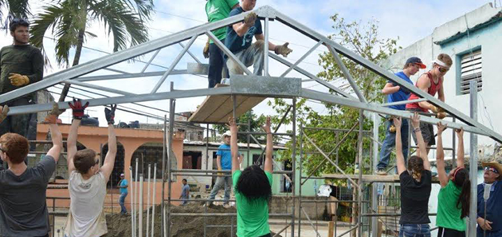 Students from Mile High, Campion, Vista Ridge academies and public and home schools work together erecting the steel frame for a church building. Photo courtesy Clint Watson.