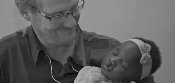 Dr. Doug Cusick cradles Nakia before he performs surgery to repair her cleft lip last year in the Dominican Republic. Photo Courtesy SMH.