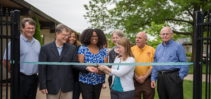 Paul Lyons, Emily Brown, Karen Miller and Amy Goode cut the ribbon to officially open the ReNewed Health Food Pantry in Overland Park, Kansas. Also pictured (back, l-r) are Douglas Elsey and Chanda Nunes, New Haven pastors; John Treolo, conference community services director; and Douglas Carruthers, New Haven community services director. Photo by Tim Floyd.