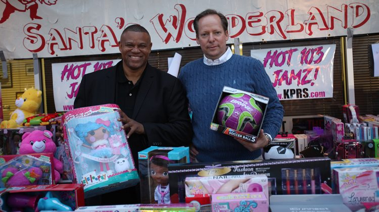 Dwayne Williams (left), president/CEO of Twelfth Street Heritage Development Corporation, and Ken Bacon, president/CEO of Shawnee Mission Health, collaborate to bring joy to children in need through the 21st annual Santa's Wonderland, an event that provides clothing and toys for thousands of economically challenged families in the Kansas City area. Photo by Rex Purefoy.