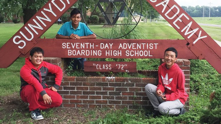 (l-r) Bee Be, Suan Lang and K Paw Soe are refugees from Myanmar who are now enrolled at Sunnydale Adventist Academy. Suan Lang began attending SAA in 2014 and is a mentor and friend to the new students. Photo by Michelle Hansen.