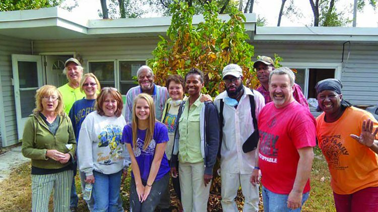 A team of volunteers from St. Louis repainted the interior of a needy family's home, making it possible for the rest of the home to be repaired. Photo by Monica McFee.