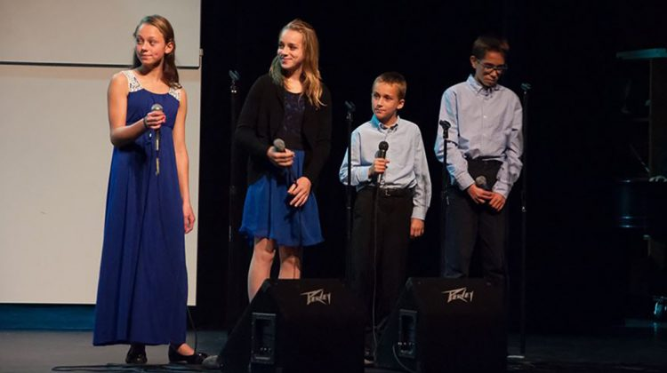 Members of local community and high school choirs, along with other musicians including this quartet of Russian teenagers, joined together in presenting a benefit concert for refugee children. Over $4,500 was sent to the UNICEF Refugee Project. Photo by Wild Trillium Photography.