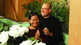 Pastor Eddie Cabrera baptizes Pen at the Muscatine Church in Iowa. Photo by Vonda Hinkhouse.