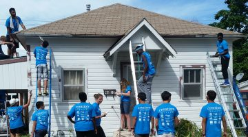 Students, local church members and hosptial employees volunteered to paint five homes of elderly and disabled community members in the Denver area. Photo courtesy Rocky Mountain Adventist Health/Centura Health.