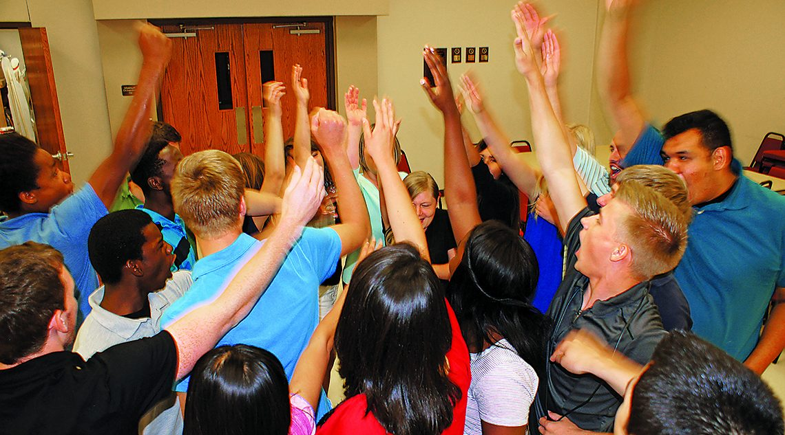 "After having worship and praying together the 2015 Youth Alive team gets fired up for the day with their morning cheer, ""Maranatha! Jesus is coming soon!"" Photo by Edy Infante."