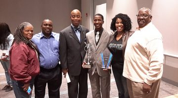 Joseph Smittick celebrates his awards with his parents, grandparents and the Honorable Chaplain Barry C. Black (third from left). Photo courtesy Central States Conference.