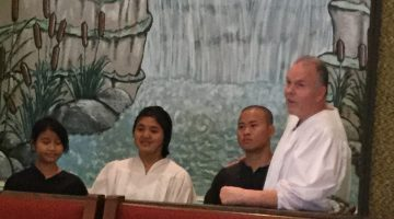 Pastor Brad Traxler Baptizing at Huron, South Dakota Church R to L: Maw Lay, Paw Lay, Moo Nay Hser.