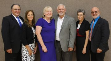 All three of Iowa-Missouri's officers were elected to continue in their respective roles for another term. Pictured with their spouses (l-r) Robert Wagley, executive secretary; Peggy Wagley, administrative assistant to the president and ministerial/evangelism departments; Gail Coridan, women's/health ministries director and prayer coordinator; Dean Coridan, president; Rhonda Karr, treasurer; Ron Karr.