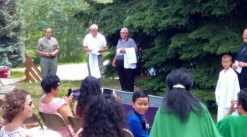 Aspen Park Church holds a baptism on the church's lawn. Photo: Thirza Powell