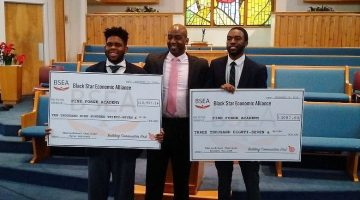 Mr. Mason West (center), event organizer, presented checks last December to the two winners, Tyler McKinney (left) and Solomon Williams. Mr. West is a class of 1988 graduate of Pine Forge Academy.