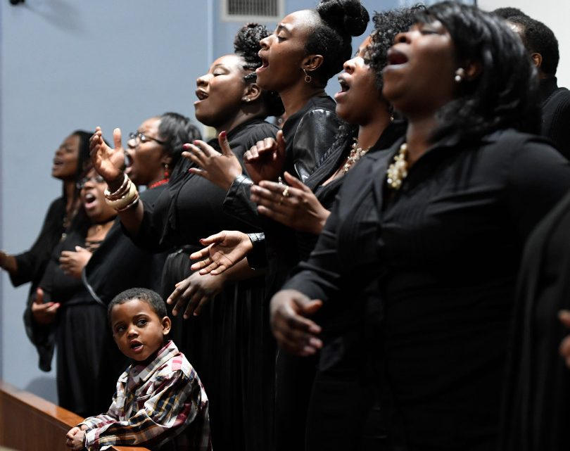 DENVER, COLORADO - JANUARY 15: Young Verron Robinson, 5, joins members of the MLK Community Choir as they sing during an Interfaith service at Park Hill Seventh Day Adventist Church on January 15, 2017 in Denver, Colorado. The Greater Metro Denver Ministerial Alliance hosted the service before Martin Luther King Day.  The service is one of the major functions in the city, celebrating the life, memory and ministry of Reverend Dr. Martin Luther King Jr. As one of the premier African-American faith organizations in Colorado, GMDMA uses the occasion to bridge and build greater continuity in all communities in the spirit of Dr. King.   (Photo by Helen H. Richardson/The Denver Post)