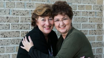Rita Martin (l) and Jackie McKeown Bishop were best friends through high school until a painful grudge dissolved their relationship. After not speaking for years, last summer the two extended mutual forgiveness and restored their friendship. Photo: Sarah Christine Photography