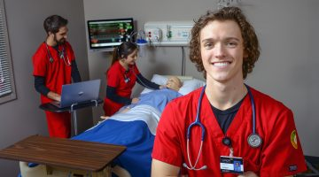Zachary Krall transferred to Union College from his Florida nursing school last fall after seeing the dedication of Union's faculty and the way they use Union's Nursing Simulation Center to teach students how to make treatment decisions in a wide variety of situations. Photo: Steve Nazario/Union College