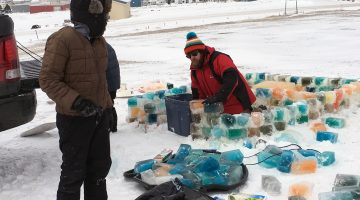 Willie Hale constructing the ice sanctuary out of blocks of ice. Photo: Endine Karges