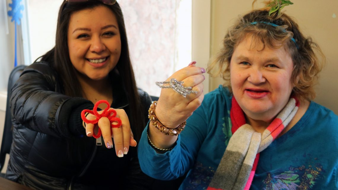 Participants at Global Youth Day made pipe cleaner flowers with nursing home residents, fleece blankets for a local homeless shelter and food to be given out on the street. Photo: Minnesota Conference