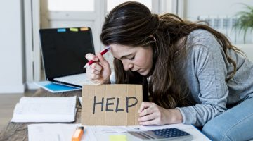young woman asking for help suffering stress doing domestic accounting