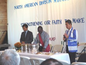 Elder Gil Webb, vice president of administration for the Mid-America Union Conference, officiates during a communion service at the 2017 NAD Myanmar Adventist Convention held in Minnesota.