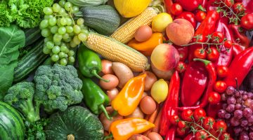 Fruits and vegetables overhead assortment on colorful background